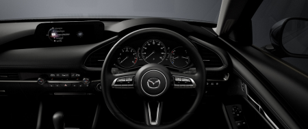 Can you guess this Mazda model from the interior?